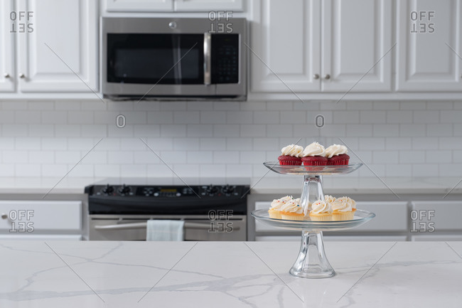 Display of cupcakes in white kitchen