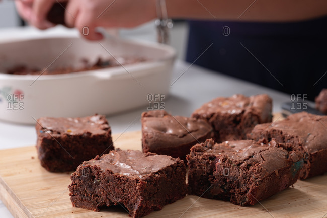 Woman baking brownies in kitchen at home