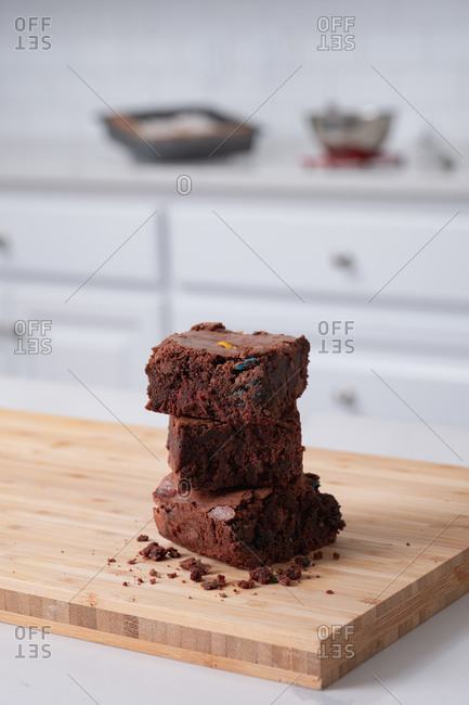 Stack of brownies on cutting board in kitchen