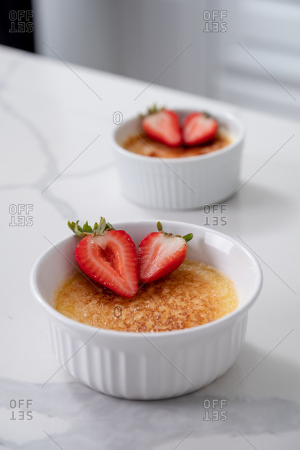 Homemade creme brulee in white kitchen