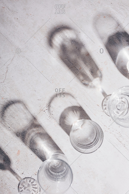 Light refractions from drinking glasses on light surface