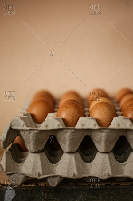 Stacked cartons with brown eggs