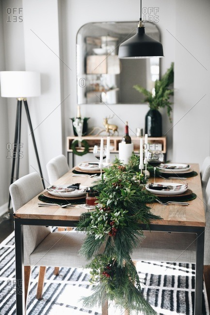 A table set with classic holiday decor and place settings
