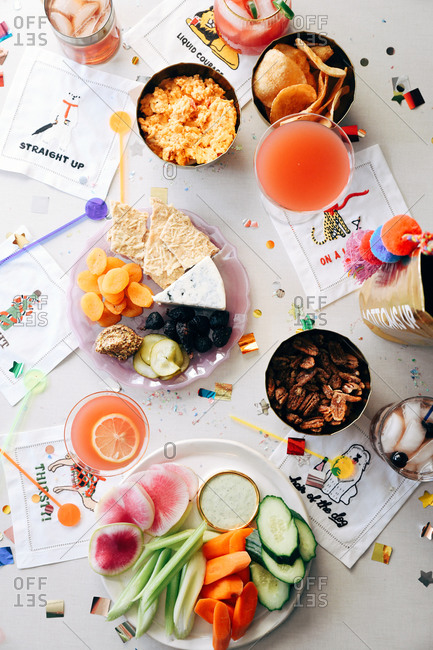 Overhead view of appetizers and cocktails at a party