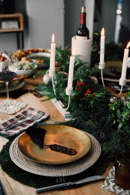 Christmas gathering table set with classic holiday decor and wine