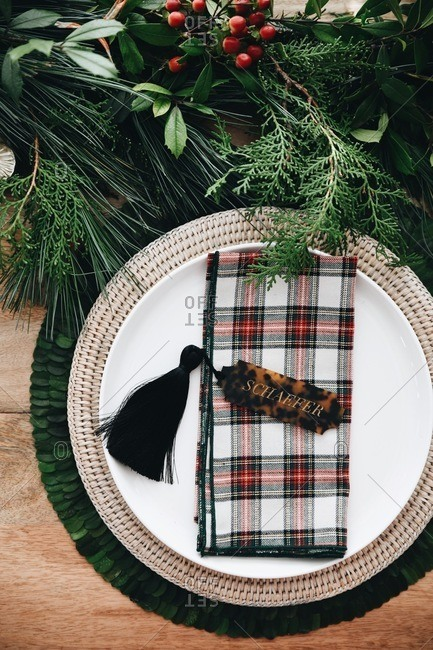 Top view of a place setting on a table set with classic holiday decor