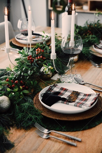 Classic Christmas decor on table set for a small holiday party