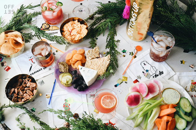 Top view of appetizers and cocktails at a party