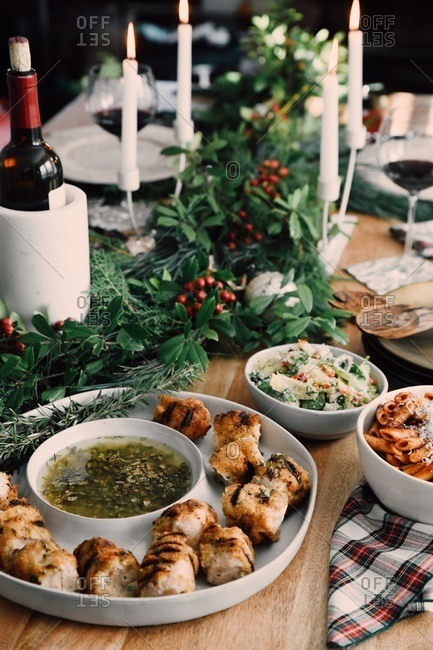 Food on a dinner table set for a small Christmas gathering