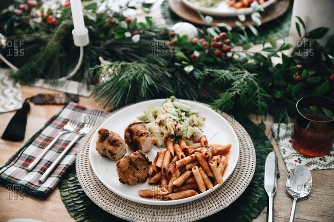 Dinner served for a small Christmas gathering on plate