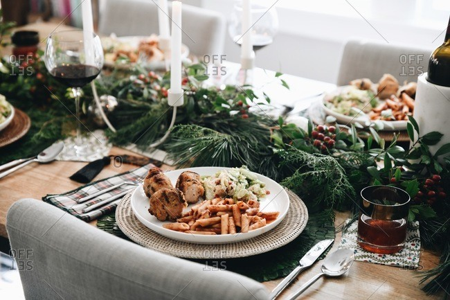 Three course meal served for a small Christmas gathering on a decorated table