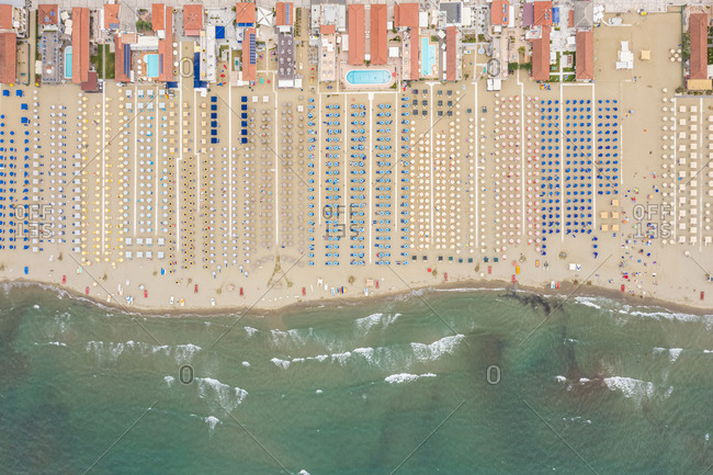 Aerial view of huge beach with many umbrella's in Viareggio, Italy.