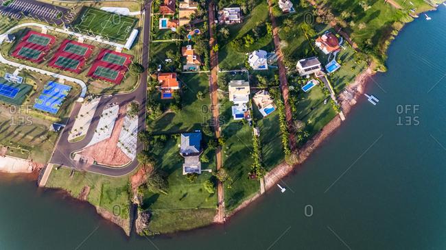 Aerial View Of Houses And Club House Facilities In Luxury Riverside Condominium, Paranapanema, São Paulo, Brazil