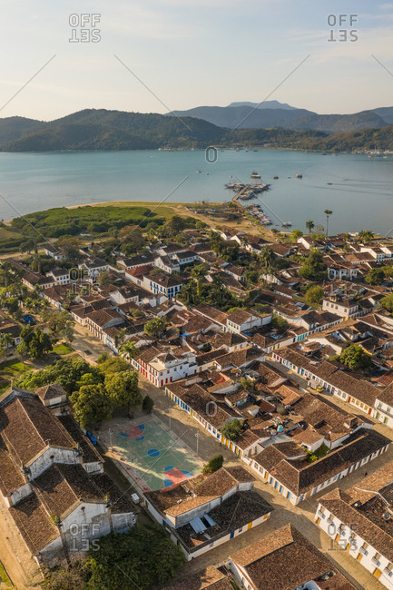 Aerial View Of Colorful Traditional Streets In Historical City Center Of Paraty, Islands In Distance, Rio De Janeiro, Brazil