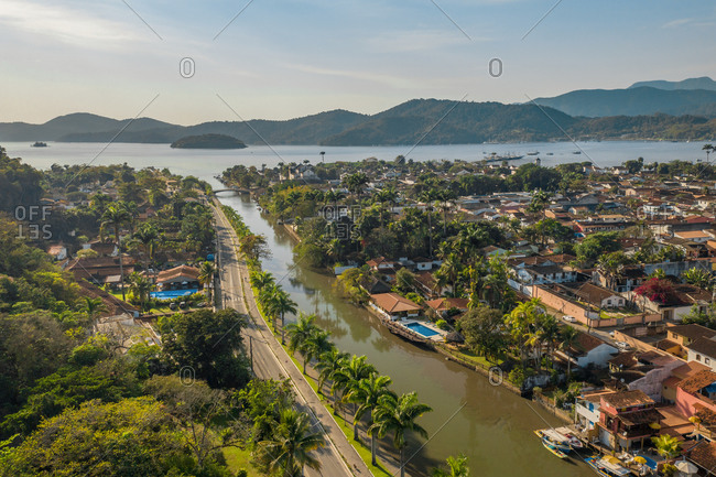 Aerial View Of River And Paraty Historical City Center Surrounded In Tropical Palm Trees, Islands In Distance, Rio De Janeiro, Brazil