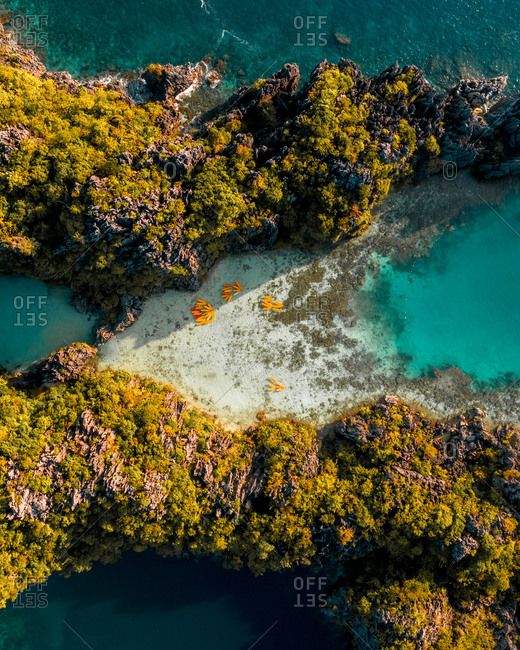 Aerial view of kayaks attached together in pattern in bay of El Nido, the Philippines.
