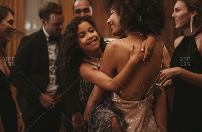 Mother and daughter having fun at a party. Woman dancing with her cute girl at party.