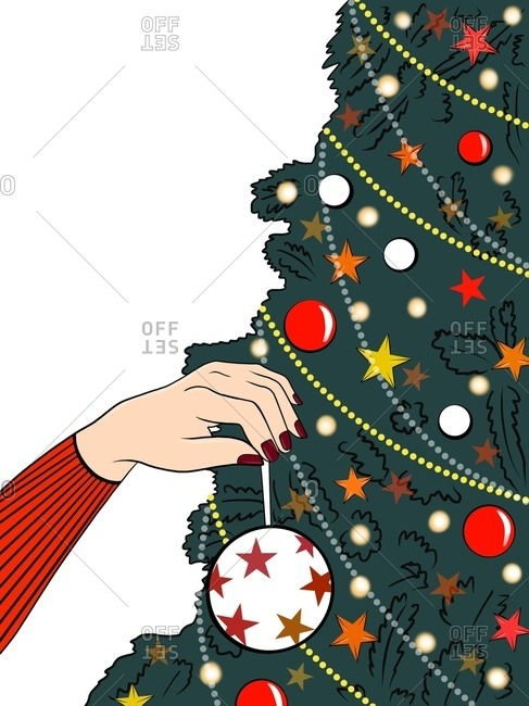 Woman in red sweater hanging white bauble on Christmas tree