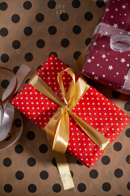 Red polka dots gift box with golden bow