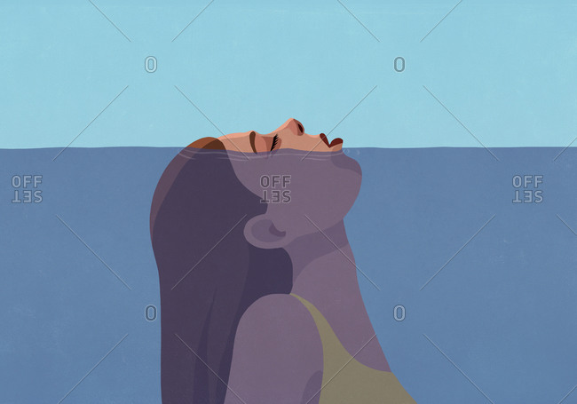 Woman gasping for air above water