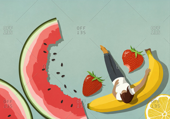 Woman relaxing among different fruit