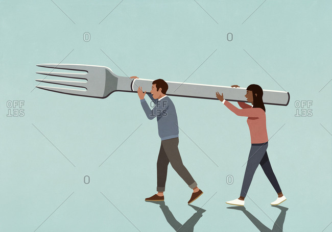 Couple carrying large fork together