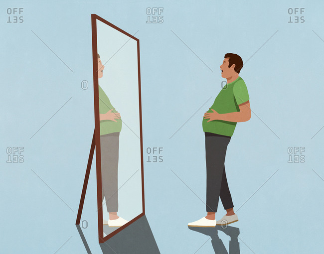 Surprised man looking at large stomach in mirror