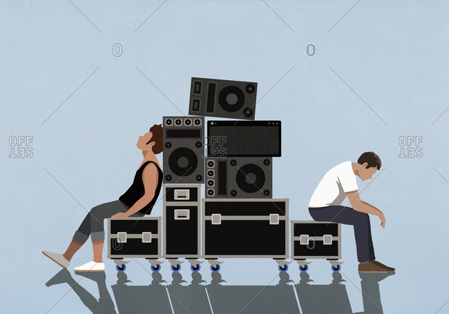 Tired young men relaxing on crates of music equipment