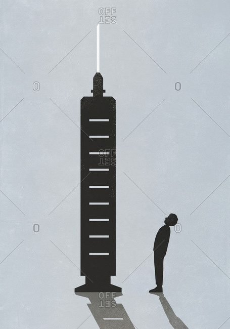 Silhouette of man standing below large vaccine syringe