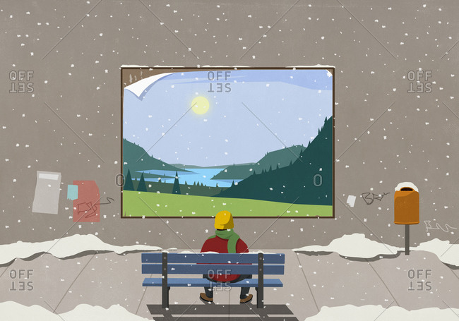 Man on snowy city bench looking at scenic rural billboard