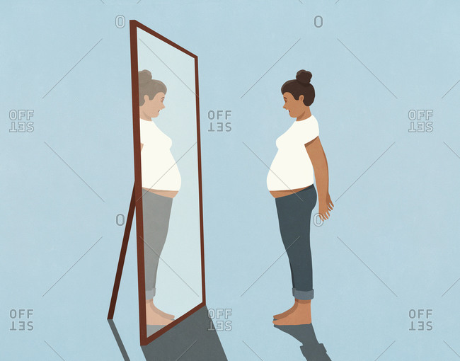 Woman looking at large stomach in mirror