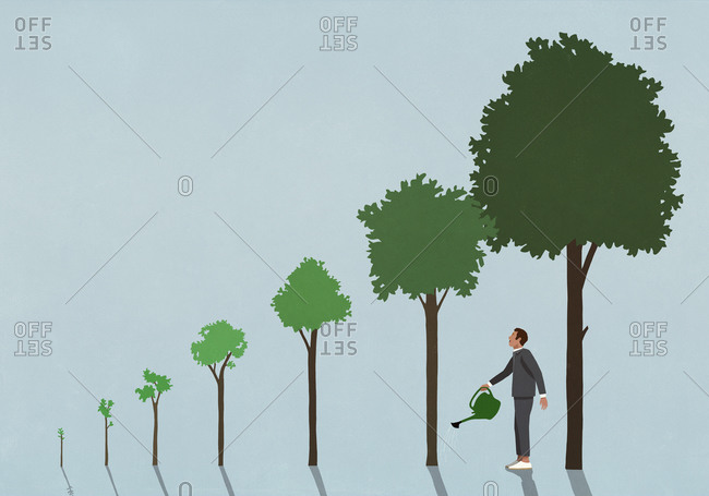 Businessman watering growing trees with watering can