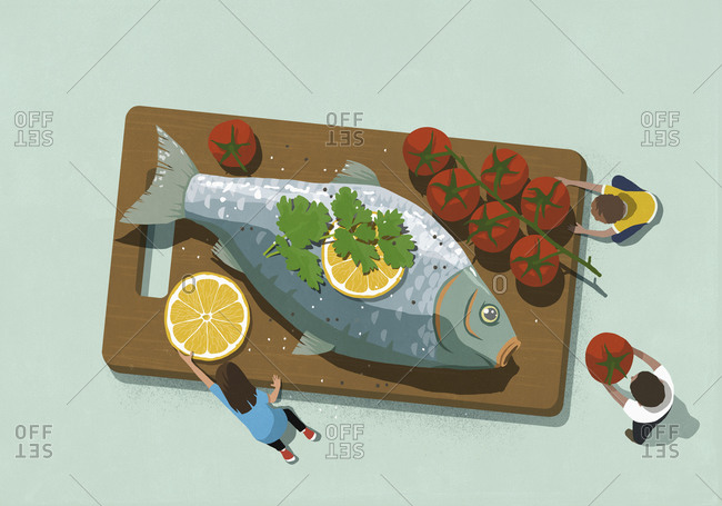Family sharing large fish dinner with tomatoes