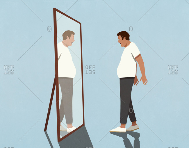 Surprised man looking at reflection of large stomach in mirror