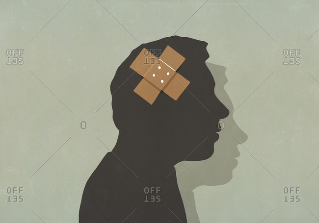 Adhesive bandage over silhouette of mans brain