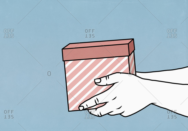 Hands holding gift box on blue background