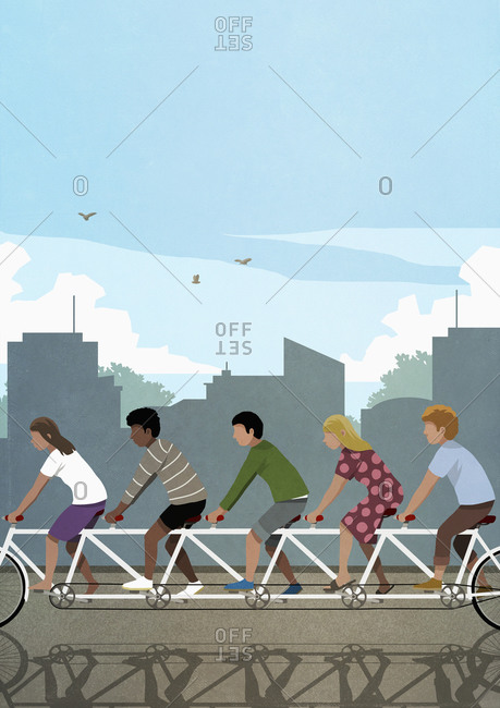 Diverse friends riding tandem bicycle in city