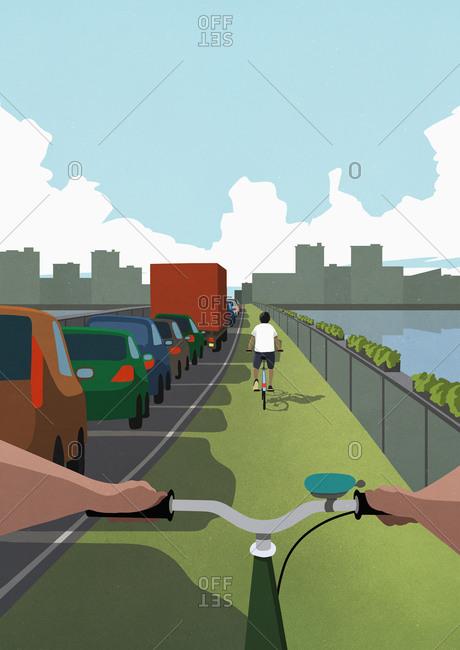POV bicycles in green lane passing cars in urban traffic jam