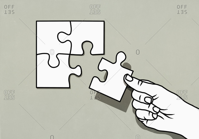 Hand finishing jigsaw puzzle with missing piece