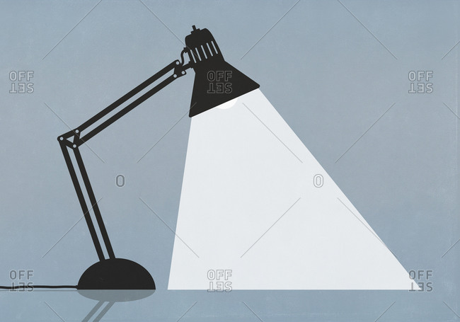 Bright task lamp shining on blue background