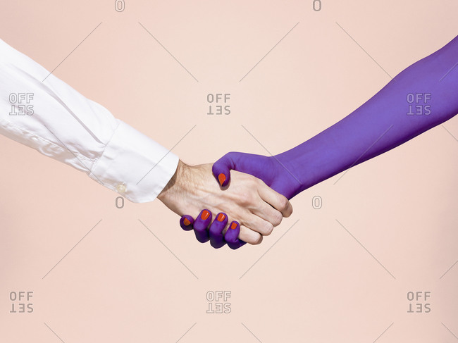 Abstract handshake on pink background