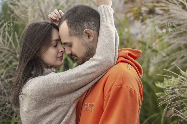 Affectionate, sensual young couple hugging