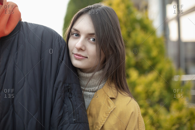 Portrait confident beautiful young woman with boyfriend