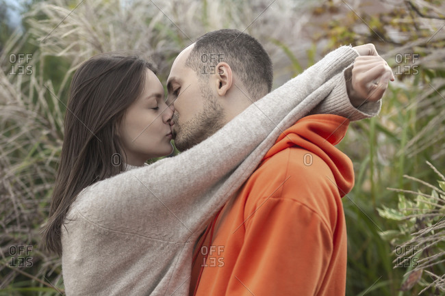 Sensual, affectionate young couple kissing