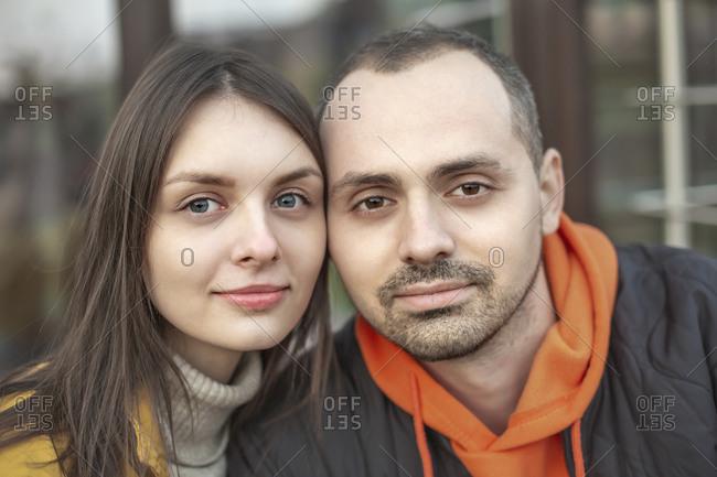 Portrait confident, attractive young brunette couple