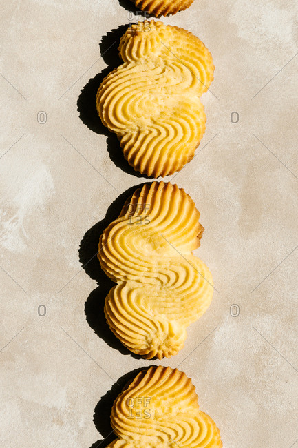 Top view of delicious crunchy pastries with colorful decorative surface on table in daylight