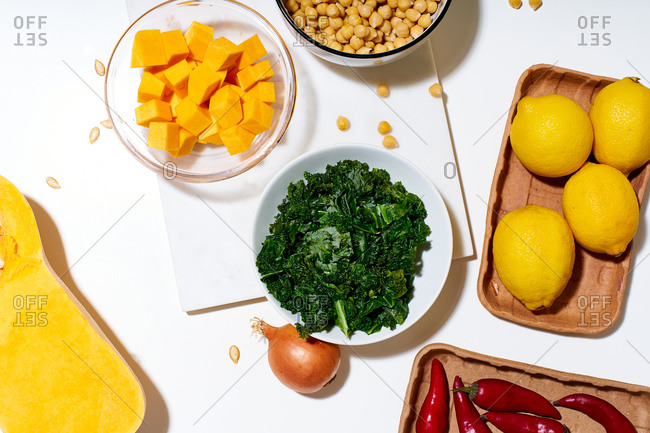 Cooking a salad with lemon, chickpeas and kale