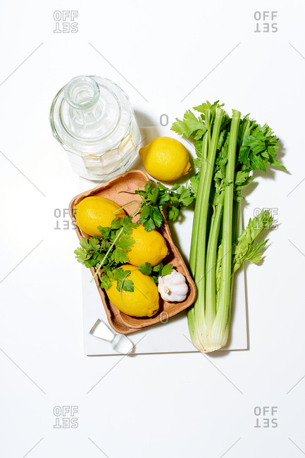 Flat lay with lemons, celery and parsley