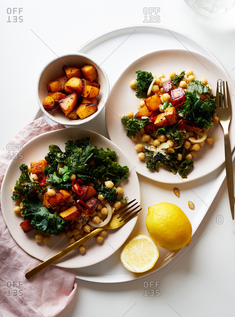 Healthy vegetarian salad with chickpeas, kale and roasted butternut squash