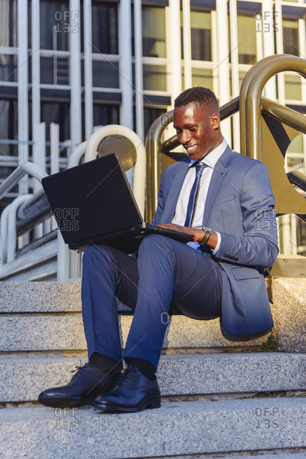 Full body side view of concentrated african american financial manager
